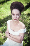 Beautiful young gothic woman in white shirt Stock Images