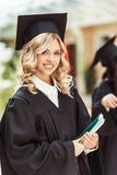 Beautiful young graduated student girl. With notebook stock photography