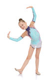 Beautiful young gymnast in a bright tracksuit Royalty Free Stock Photos