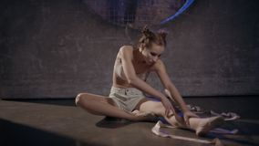 Beautiful young gymnast woman posing with gymnastics tape stock video