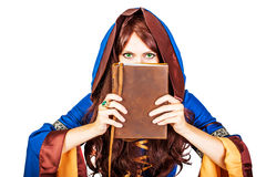 Beautiful young halloween witch old magical book on white Royalty Free Stock Images