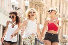 Group of smiling beautiful girls on summer vacation. stock photo