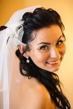 Beautiful young happy  bride standing near the window. Beautiful young happy bride standing near the window Stock Images