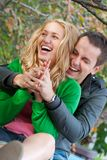 Beautiful young happy couple. In a park Stock Photos