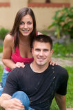 Beautiful young happy couple in the garden Stock Image
