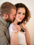 Beautiful young happy couple hugging and flirting. Royalty Free Stock Images