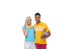 Beautiful Young Happy Couple Love Smiling Embracing Hold Tablet Computer Cell Smart Phone Call, Hispanic Man Woman Smile Stock Image