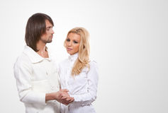 Beautiful young happy couple on grey background Royalty Free Stock Image