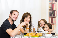 Beautiful young happy family eating meal Royalty Free Stock Photos
