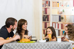 Beautiful young happy family eating meal Royalty Free Stock Photography