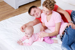 Beautiful young happy family with smiling baby Royalty Free Stock Photo