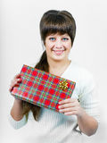 Beautiful young happy girl with a gift box Royalty Free Stock Images