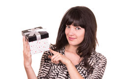 Beautiful young happy girl holding present wrapped Stock Photography