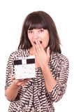 Beautiful young happy girl holding present wrapped in a box Royalty Free Stock Photo