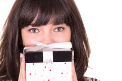 Beautiful young happy girl holding present wrapped in a box Stock Images