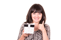 Beautiful young happy girl holding present wrapped Stock Photo