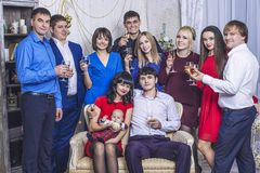 Beautiful young and happy group of people friends with glasses of champagne together to celebrate. Christmas stock photo