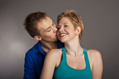 Beautiful young happy smiling couple. isolated Stock Photography