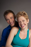 Beautiful young happy smiling couple. isolated Stock Image