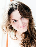 Beautiful young happy smiling woman with long curly Stock Images