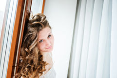 Beautiful young happy smiling woman with long curly Royalty Free Stock Photo