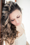 Beautiful young happy smiling woman with long curly Royalty Free Stock Image