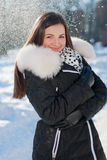 Beautiful young smiling girl on the snow outdoors background Stock Photo