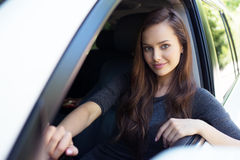 Beautiful young happy woman in car. royalty free stock photos