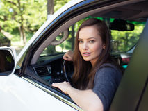 Beautiful young happy woman in car. Royalty Free Stock Photography