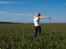 Beautiful young happy woman in a field Stock Photography