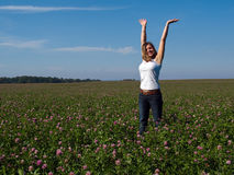 Beautiful young happy woman in a field Stock Images