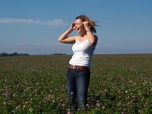 Beautiful young happy woman girl in a field Royalty Free Stock Images
