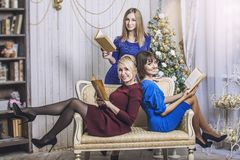 Beautiful young and happy woman girlfriend celebrate Christmas Stock Images