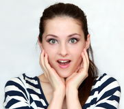 Beautiful young happy woman holding face Royalty Free Stock Photo