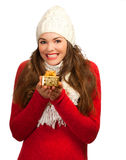 Beautiful young happy woman  holding small gift. A beautiful young woman smiling and holding a small beautifully wrapped Christmas present. Isolated on white Royalty Free Stock Photo