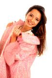 Beautiful young happy woman in pink fur coat Royalty Free Stock Images