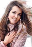 Beautiful young happy woman portrait against seascape, long hair fluttering in the wind, looking at camera, casual autumn fashion Stock Photos