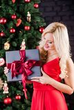 Beautiful young happy woman with present box stock photo