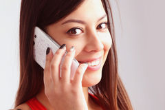 Beautiful young happy woman smiling during a phone call stock photography