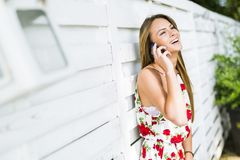 Beautiful young happy woman smiling during a phone call Royalty Free Stock Images