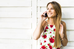 Beautiful young happy woman smiling during a phone call Stock Images