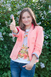 Beautiful young happy woman smiling with thumb up Stock Images