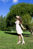 Beautiful young happy woman under blue sky. Royalty Free Stock Image