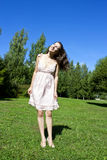Beautiful young happy woman under blue sky. Royalty Free Stock Photos