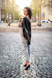 Beautiful young happy woman walking on the street stock photography