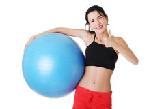 Beautiful young woman with pilates exercise ball. Royalty Free Stock Images