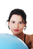 Beautiful young woman with pilates exercise ball. Stock Photo