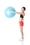 Beautiful young woman with pilates exercise ball. Stock Photos