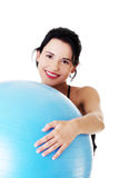 Beautiful young woman with pilates exercise ball. Royalty Free Stock Photography