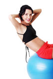 Beautiful young woman with pilates exercise ball. Stock Photography
